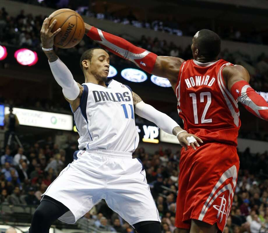 Monta Ellis (11) passes as Dwight Howard (12) pressures him. Photo: John Rhodes, McClatchy-Tribune News Service