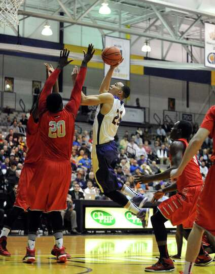 UAlbany's Gary Johnson drives to the basket during their men's America East basketball game against