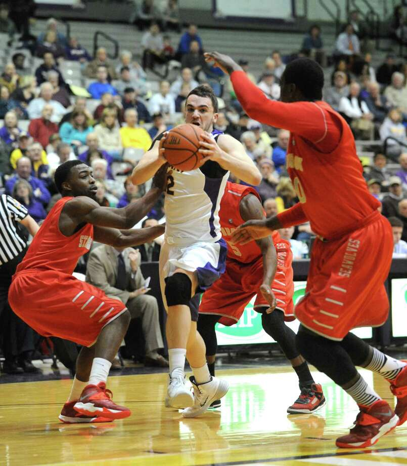 UAlbany's Peter Hooley drives to the basket during their men's America East basketball game against Stony Brook at the SEFCU Arena on Wednesday Jan. 29, 2014 in Albany, N.Y. (Michael P. Farrell/Times Union) Photo: Michael P. Farrell / 00025267A