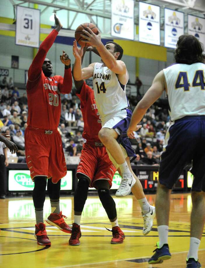 UAlbany's Sam Rowley drives to the basket during their men's America East basketball game against Stony Brook at the SEFCU Arena on Wednesday Jan. 29, 2014 in Albany, N.Y. (Michael P. Farrell/Times Union) Photo: Michael P. Farrell / 00025267A