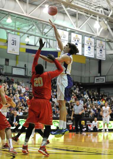 UAlbany's John Puk shoots and scores during their men's America East basketball game against Stony B