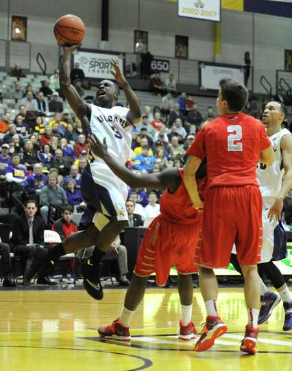 UAlbany's DJ Evans goes in for a score during their men's America East basketball game against Stony