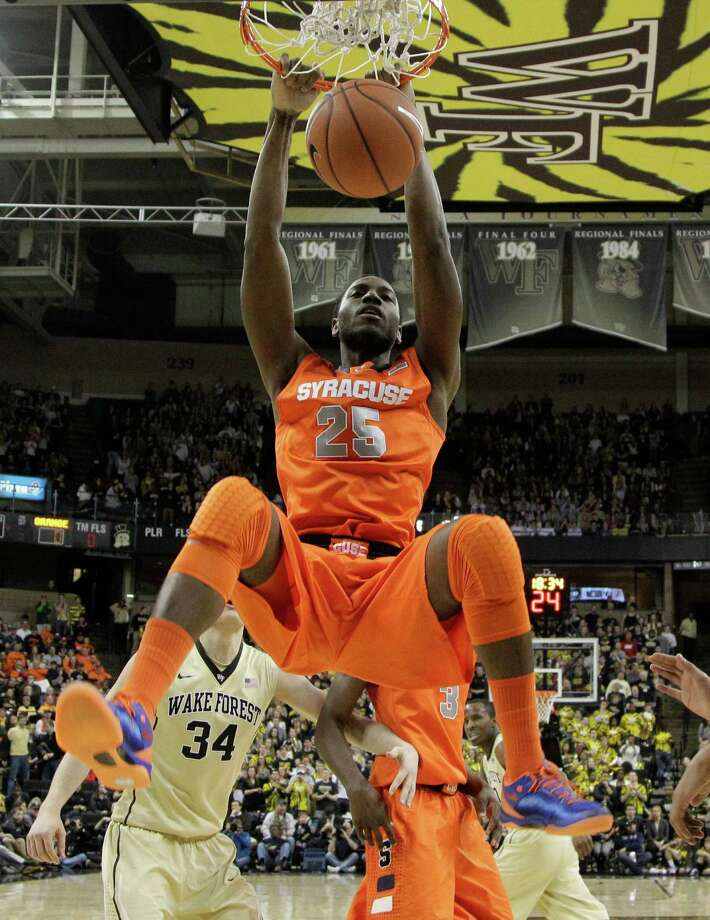 Syracuse's Rakeem Christmas (25) dunks over Wake Forest's Tyler Cavanaugh (34) during the first half of an NCAA college basketball game in Winston-Salem, N.C., Wednesday, Jan. 29, 2014. (AP Photo/Chuck Burton) ORG XMIT: NCCB101 Photo: Chuck Burton / AP