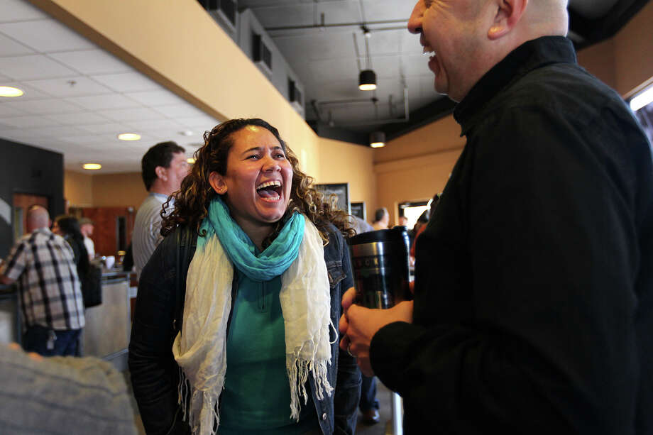 Laura Medina laughs while talking with Pastor Rey Lopez after Sunday Service  at City Church's Bandera Road campus, Jan. 26, 2014. The church's alternative-style rock band draws large number of same-sex couples and gay people. Photo: JERRY LARA, San Antonio Express-News / © 2014 San Antonio Express-News