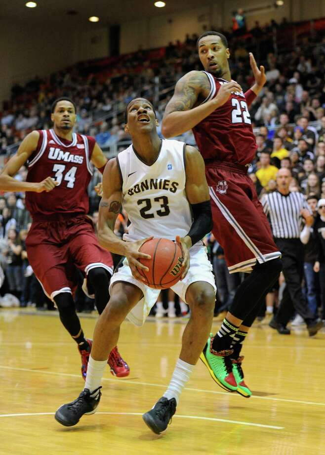 OLEAN, NY - JANUARY 29:  Andell Cumberbatch #23 of the St. Bonaventure Bonnies drives to the basket against the defense of Sampson Carter #22 of the Massachusetts Minutemen during the first half at the Reilly Center on January 29, 2014 in Olean, New York.  St. Bonaventure defeated Massachusetts 78-65.  (Photo by Rich Barnes/Getty Images) ORG XMIT: 461948565 Photo: Rich Barnes / 2014 Getty Images