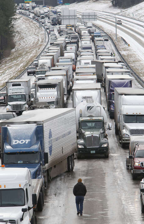 Traffic is at a standstill on Interstate 65 northbound as officials work to clear abandoned vehicles Wednesday in Hoover, Ala. Photo: Hal Yeager / Associated Press / FR170776 AP