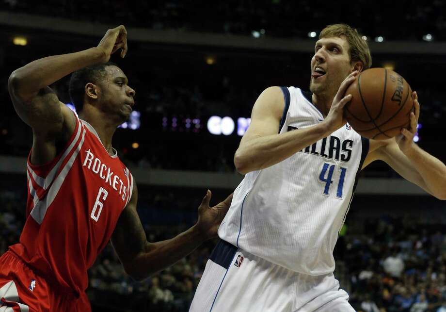 The Dallas Mavericks' Dirk Nowitzki (41) keeps the ball away from the Houston Rockets' Terrence Jones (6) during the first period at the American Airlines Center in Dallas on Wednesday, Jan. 29, 2014. (John Rhodes/Fort Worth Star-Telegram/MCT) Photo: John Rhodes, MBR / Fort Worth Star-Telegram
