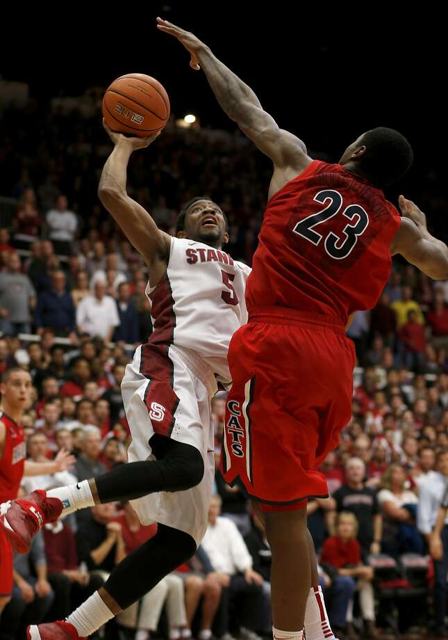 Chasson Randle looks for a shot against Rondae Hollis-Jefferson in the second half. Photo: Brant Ward, The Chronicle