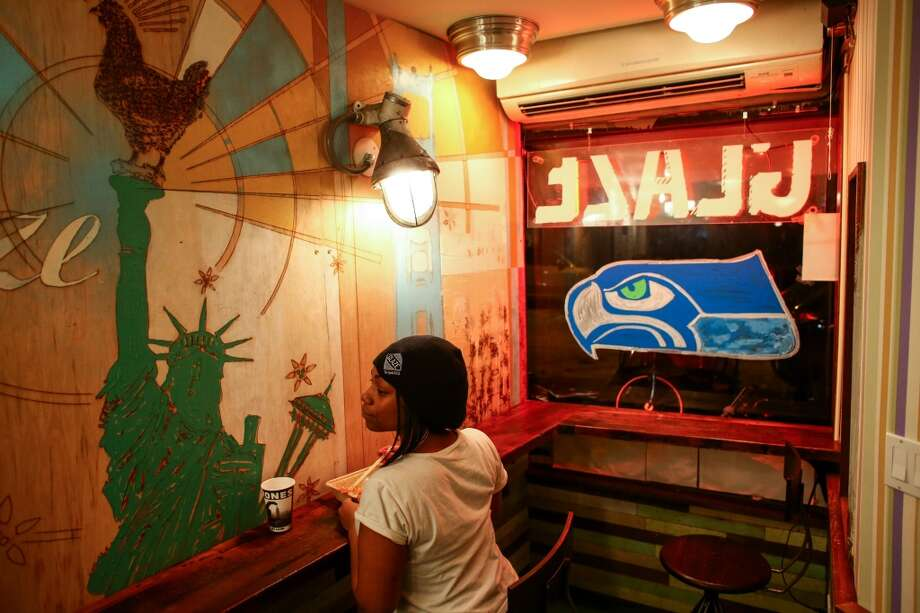 Traya Oliver takes a break during her shift at Glaze Teriyaki on West 56th Street in New York City on Wednesday, January, 29, 2014. The business is owned by Seattle native Paul Krug. With the Seahawks in town for the Super Bowl, he is offering deals to Seahawks fans. (Joshua Trujillo, seattlepi.com) Photo: SEATTLEPI.COM