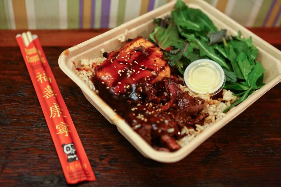 A plate of salmon and beef teriyaki is shown at Glaze Teriyaki on West 56th Street in New York City. (Joshua Trujillo, seattlepi.com) Photo: JOSHUA TRUJILLO, SEATTLEPI.COM