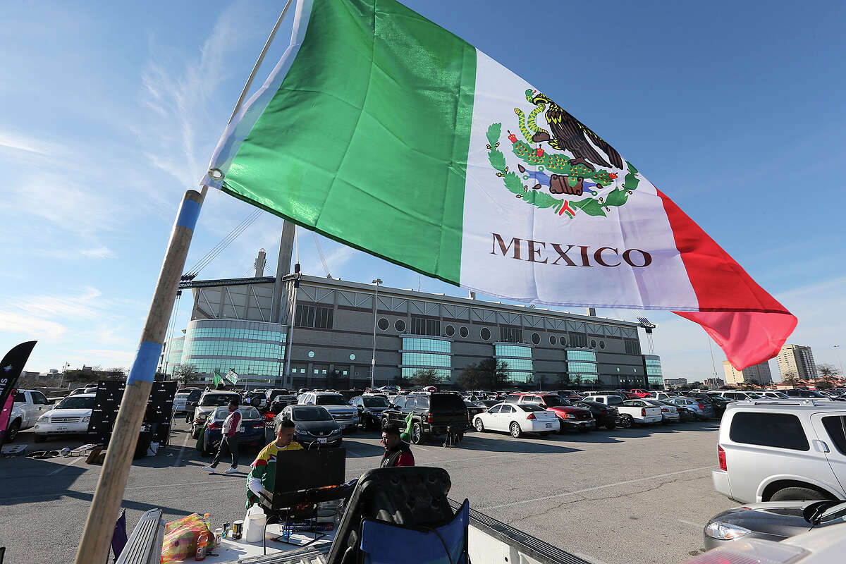 The Guerrero family, from San Antonio, cook out on the parking lot before an international friendly soccer game between the Mexican National Team and South Korea Republic at the Alamodome, Wednesday, Jan. 29, 2014.