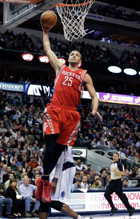 Rockets forward Chandler Parsons puts an exclamation point on two of his team-high 26 points Wednesday night. Photo: LM Otero, STF / AP