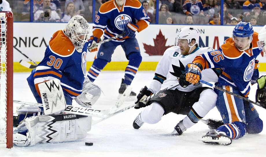 San Jose Sharks Joe Pavelski (8) is stopped by Edmonton Oilers goalie Ben Scrivens (30) as Martin Marincin (85) tries to defend during the first period of an NHL hockey game in Edmonton, Alberta, on Wednesday, Jan. 29, 2014. (AP Photo/The Canadian Press, Jason Franson) Photo: Jason Franson, Associated Press