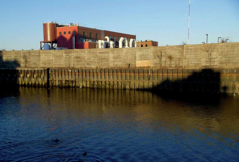 Stamford's wastewater treatment plant is seen beyond the Stamford Harbor on Wednesday, January 29, 2014. Photo: Lindsay Perry / Stamford Advocate