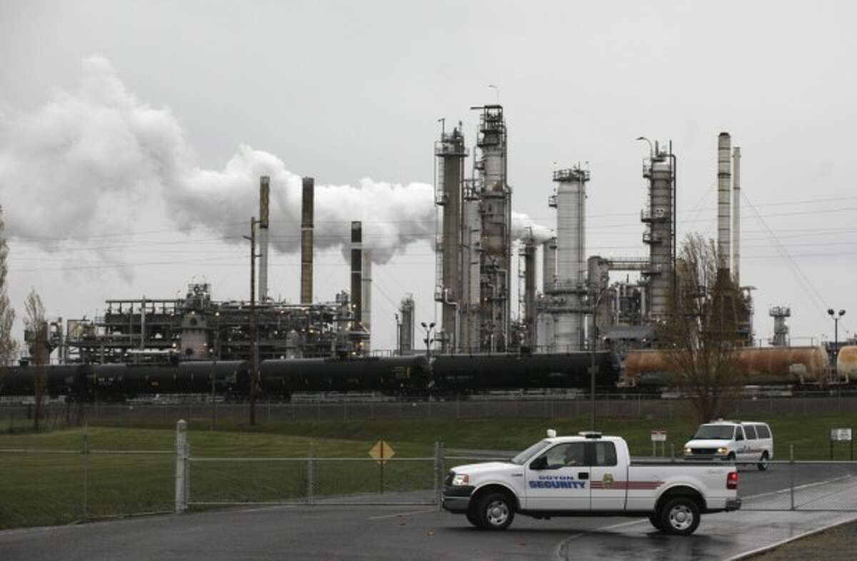 Security vehicles are shown at a gate to a Tesoro Corp. (now Andeavor) refinery , Friday, April 2, 2010, in Anacortes, Wash. A heat exchanger explosion  killed seven workers.
