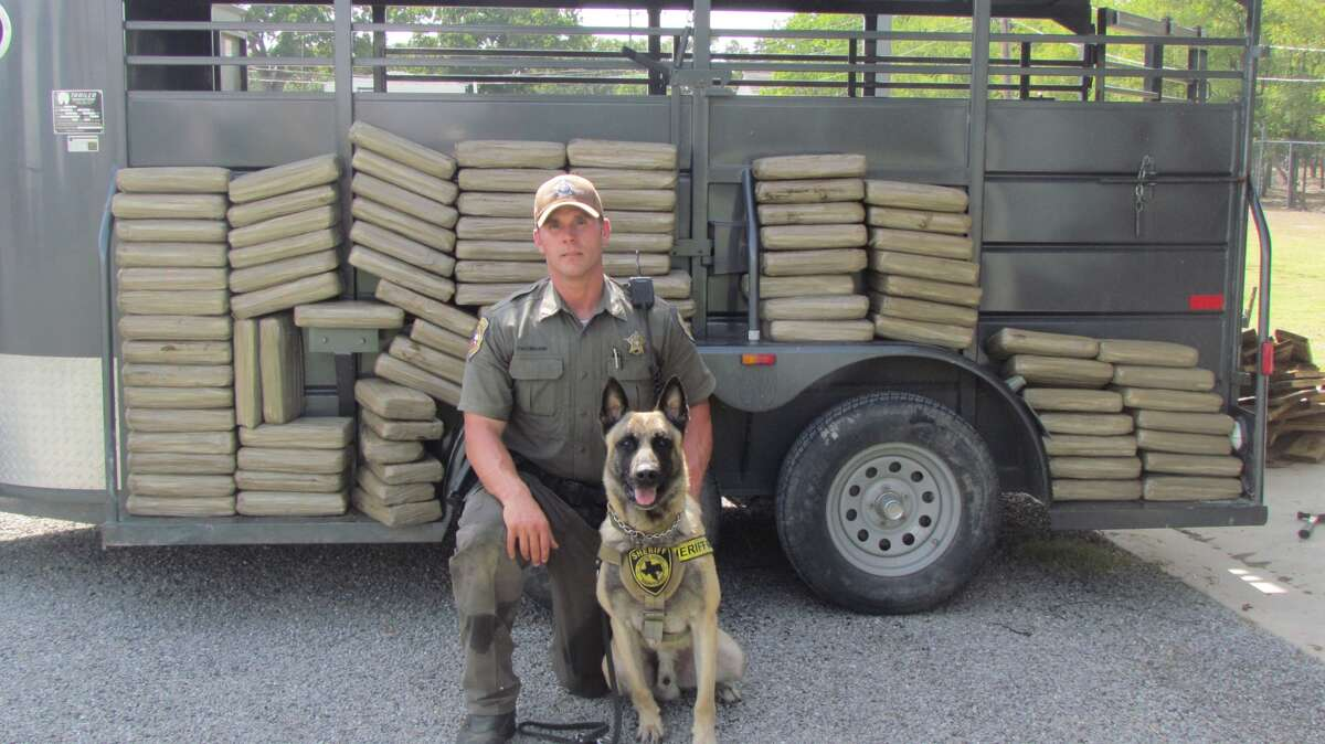Fayette County's narcotics K-9 Lobos and his partner Sgt. Randy Thurmann, who is credited with the team's interdiction success.