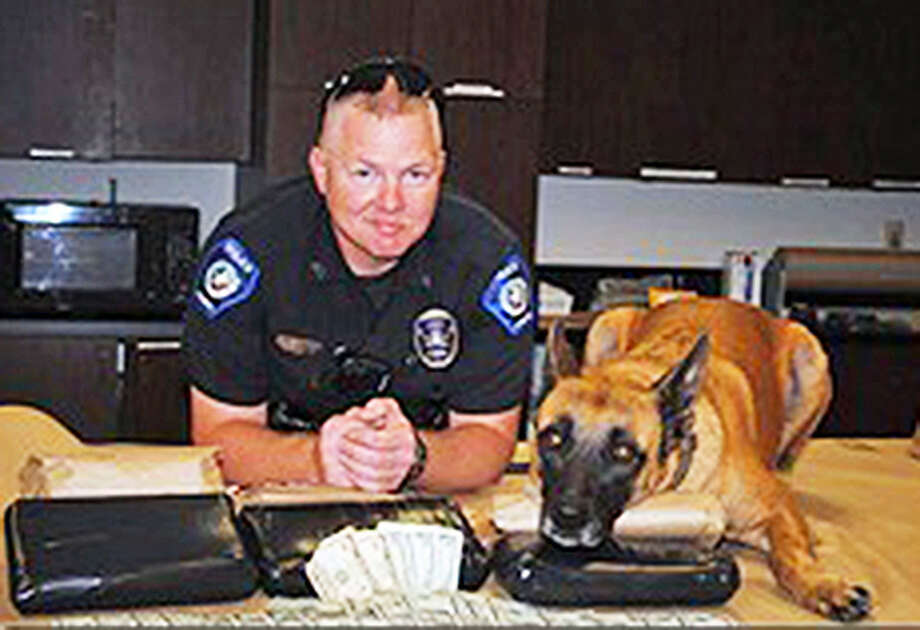 Officer Clyde Vogel and his canine partner, Cassie, arrested Morris Alexander Wise for possession of 8.8 kilograms of cocaine valued at $1.3 million on Sept. 15, 2011. A final court ruling this week took the shine off that major bust. Photo: Scott Engle, Montgomery County Police Reporter