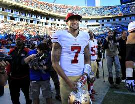 Colin Kaepernick (7) smiled as the last seconds ticked off for a 49er victory Sunday January 12, 2014. The San Francisco 49ers beat the Carolina Panthers 23-10 in Charlotte, North Carolina to advance to the NFC title game against Seattle.