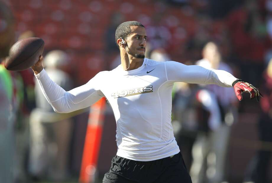 49er quarterback Colin Kaepernick, (7) warming up before the start of the game as the San Francisco 49ers prepare to take on the St. Louis Rams at Candlestick Park in San Francisco, Ca., on Sunday Dec. 1, 2013. Photo: Michael Macor, The Chronicle