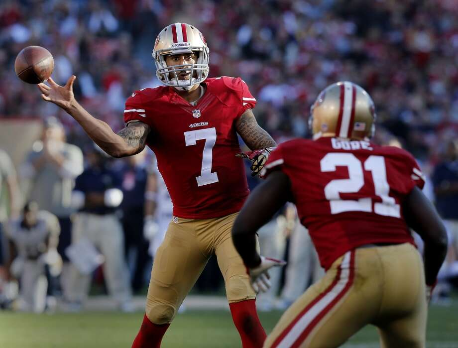 Colin Kaepernick completed a short pass to Frank Gore in the second half. The San Francisco 49ers defeated the St. Louis Rams 23-13 at Candlestick Park Sunday December 1, 2013. Photo: Brant Ward, The Chronicle