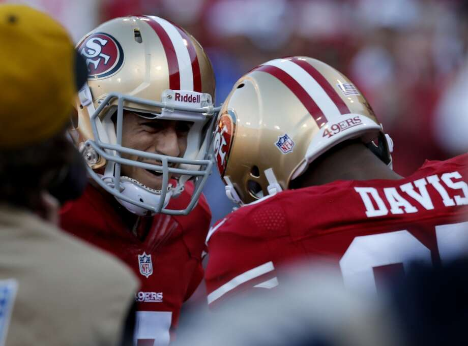 Colin Kaepernick (7) congratulates Vernon Davis in the endzone after his touchdown. The San Francisco 49ers defeated the St. Louis Rams 23-13 at Candlestick Park Sunday December 1, 2013. Photo: Brant Ward, The Chronicle