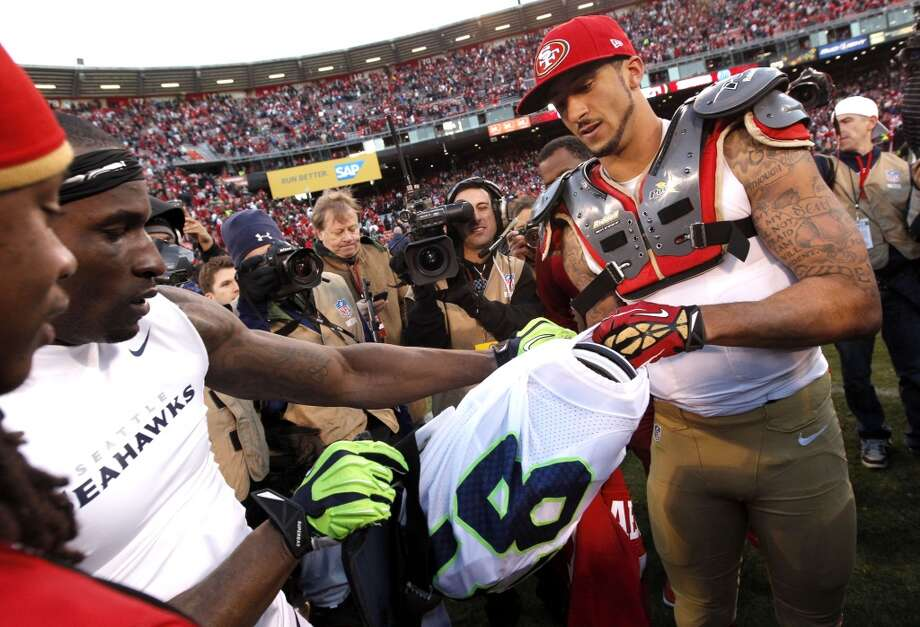 Seattle's Ricardo Lockette, (left) and 49ers' quarterback Colin Kaepernick, exchange uniforns at the end of the game, as the San Francisco 49ers beat the Seattle Seahawks 19-17, at Candlestick Park on Sunday Dec. 8, 2013, in San Francisco, Ca. Photo: Michael Macor, The Chronicle