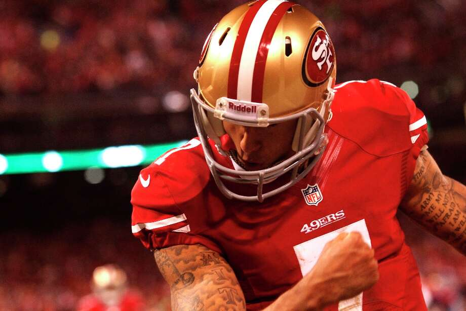 "Kaepernick ""Kaepernicks"" after scoring a touchdown in the third quarter of the San Francisco 49ers game against the Green Bay Packers. Photo: Brant Ward, The Chronicle / ONLINE_YES"
