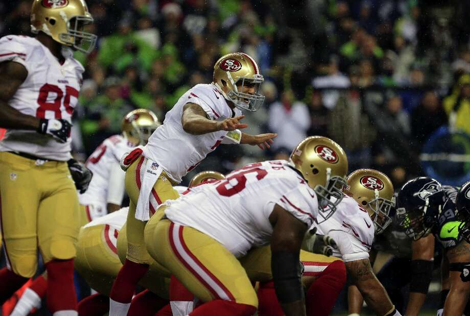 Colin Kaepernick calls out to his teammates at the line of scrimmage during the first half of the Seahawks and 49ers game Sunday, Dec. 23, 2012, at CenturyLink Field in Seattle, WA. Photo: Jordan Stead, Special To The Chronicle / ONLINE_YES