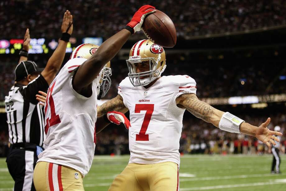 Frank Gore and Colin Kaepernick celebrate after scoring a touchdown against the New Orleans Saints at the Superdome on November 25, 2012 in New Orleans, Louisiana. Photo: Chris Graythen, Getty Images / 2012 Getty Images
