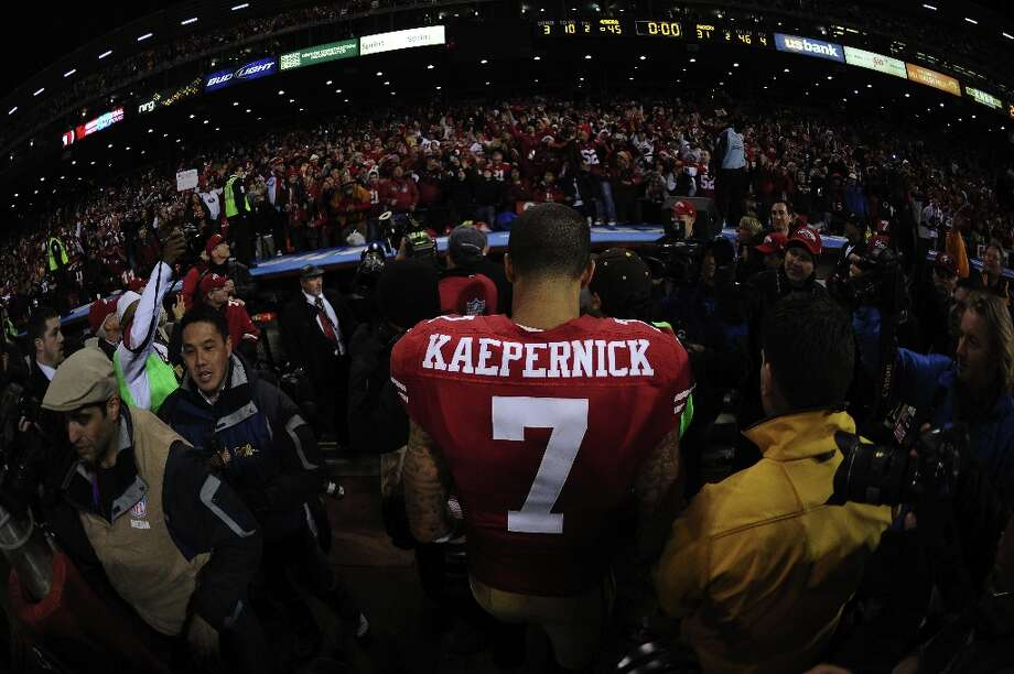 Kap walks off the field after defeating the Green Bay Packers in the NFC Divisional Playoff Game at Candlestick Park. Photo: Harry How, Getty Images / 2013 Getty Images