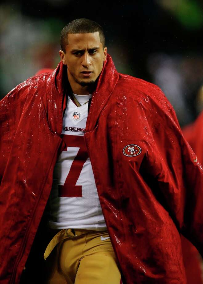 San Francisco 49ers quarterback Colin Kaepernick stands on the sideline in Seattle. Photo: John Froschauer, Associated Press / FR74207 AP