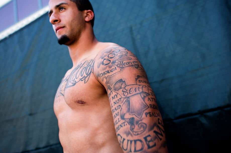 More tattoos, mostly of the religious variety. Photo: Michael Short, Special To The Chronicle / ONLINE_YES
