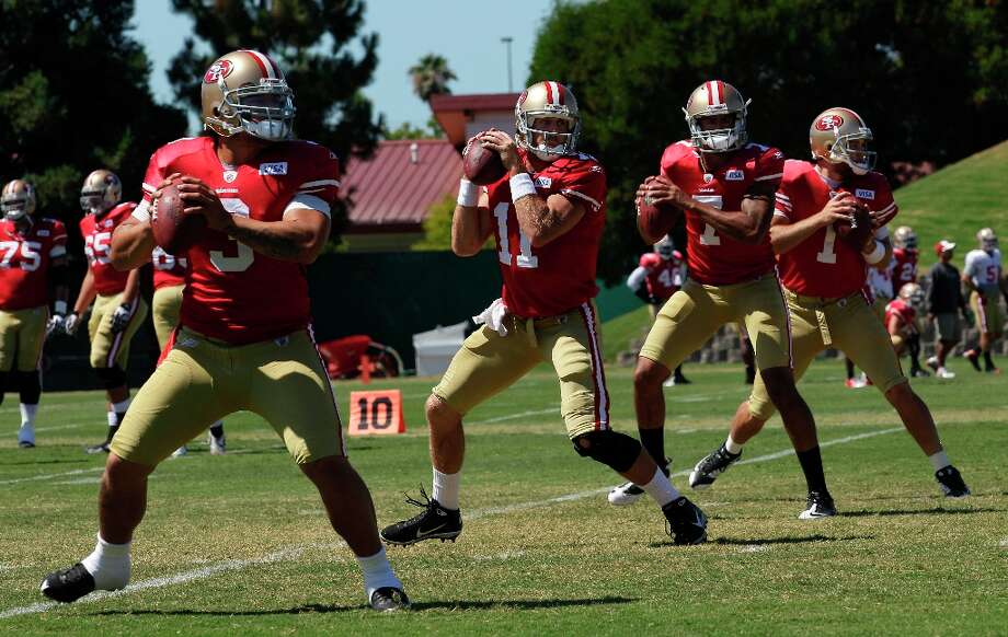 Remember these guys? San Francisco 49ers quarterbacks Jeremiah Masoli, Alex Smith, Colin Kaepernick and McLeod Bethel-Thompson practice during training camp in Santa Clara, Calif., back in 2011. Photo: Jeff Chiu, AP / AP