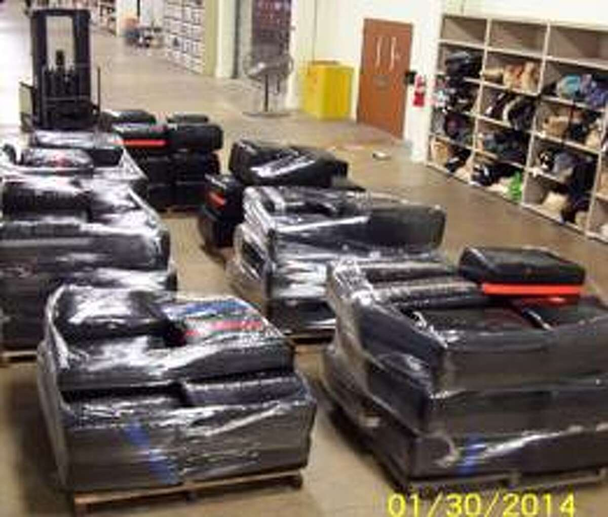 Jan. 30, 2014: Bundles of marijuana, totaling an estimated 5,076 pounds, seized by SAPD from an 18-wheeler truck and trailer Thursday in downtown San Antonio.