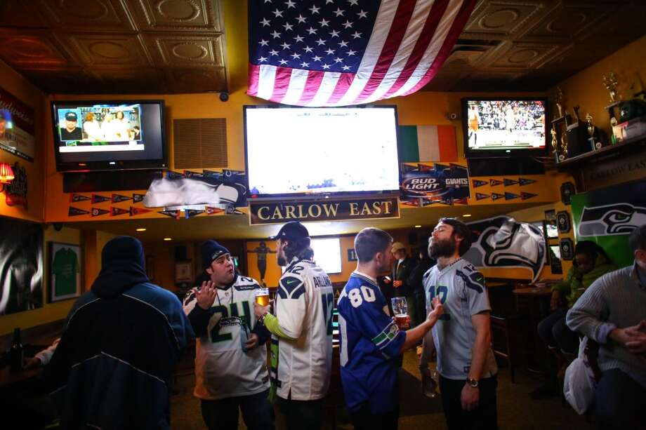 Seattle natives and Seahawks fans gather at Carlow East in the upper east side of Manhattan. The bar is known as a hub for people from Seattle. Photographed on Wednesday, January, 29, 2014. (Joshua Trujillo, seattlepi.com) Photo: SEATTLEPI.COM