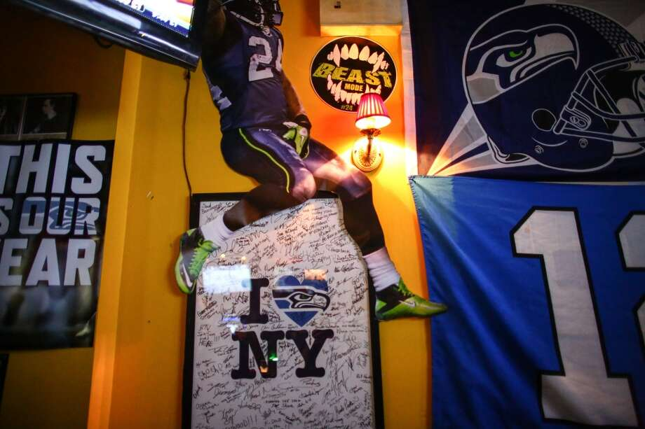 Seahawks posters and images are shown on a wall at Carlow East in the upper east side of Manhattan. The bar is known as a hub for people from Seattle. Photographed on Wednesday, January, 29, 2014. (Joshua Trujillo, seattlepi.com) Photo: SEATTLEPI.COM