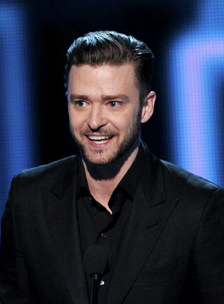 """LOS ANGELES, CA - JANUARY 08:  Singer-actor Justin Timberlake accepts the Favorite Album award for """"The 20/20 Experience"""" onstage at The 40th Annual People's Choice Awards at Nokia Theatre L.A. Live on January 8, 2014 in Los Angeles, California.  (Photo by Kevin Winter/Getty Images) Photo: Kevin Winter, Staff / 2014 Getty Images"""