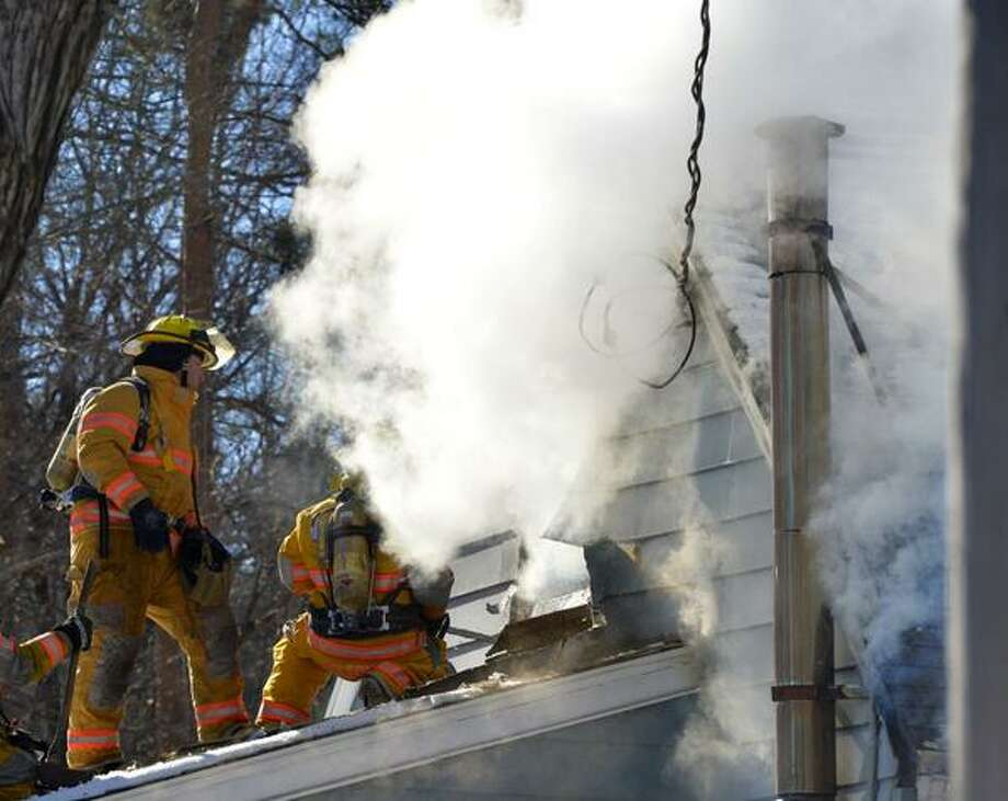 Firefighters battle a blaze at a home on Morey Park Road in Schodack on Thursday. (Skip Dickstein / Times Union)