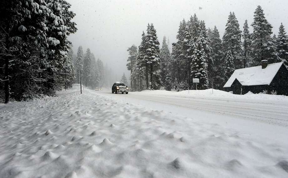 Snow falls along Highway 50 at Phillips Station, Calif. on Thursday Jan. 30, 2013, as the Department of Water Resources surveyors prepare to take the second snow survey of the winter season. Photo: Michael Macor, The Chronicle