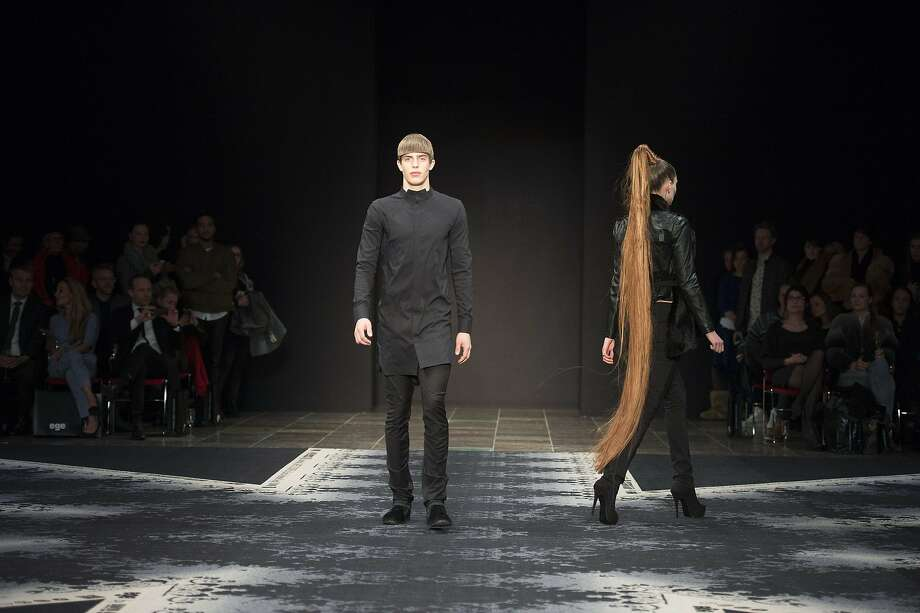Rapunzel, Rapunzel ... Models present creations from the Autumn/Winter 2014 collection by David Andersen during 
