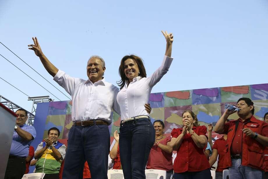 Vice President Salvador Sanchez Ceren (left), a presidential candidate, campaigns with Vanda Pignato. Photo: Luis Lopez, Associated Press
