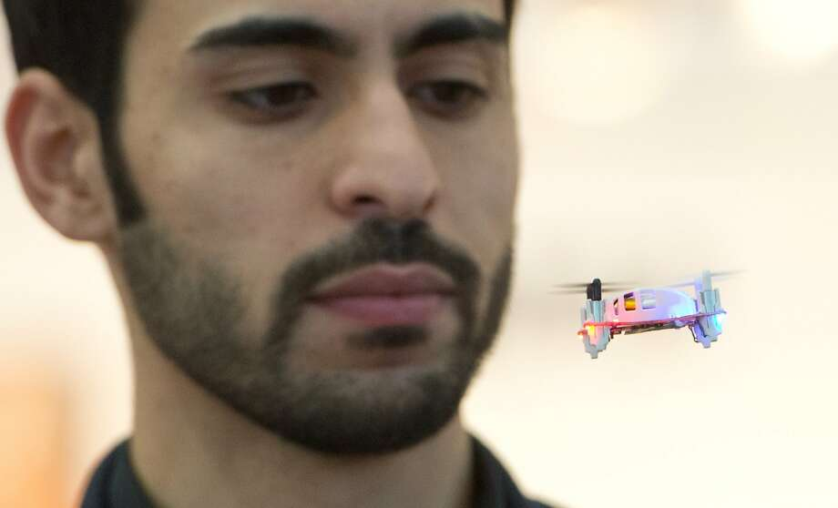 "Downsized drone:A remote-controlled ""mini-multicopter"" nearly trims a beard at the Nuremberg International Toy Fair  in 