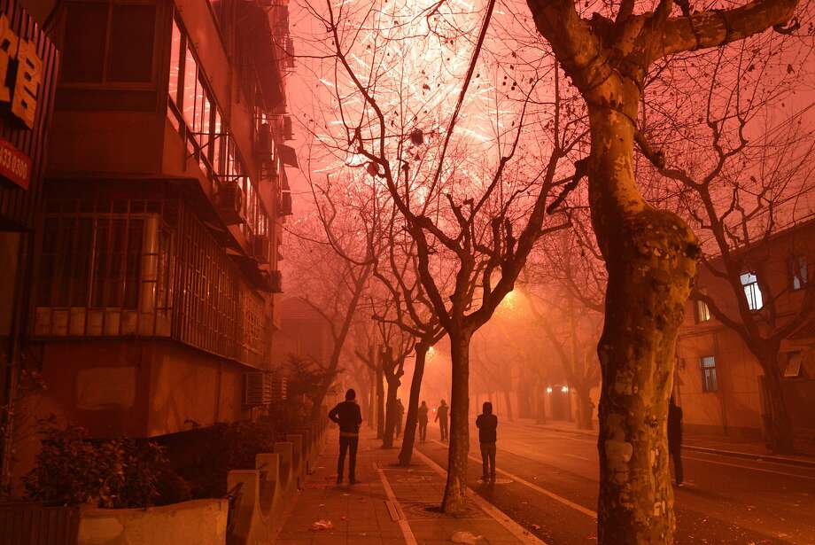 Happy New Year, China! Fireworks explode in a street of Shanghai on the eve of the Chinese New Year. China was welcoming the Lunar New 