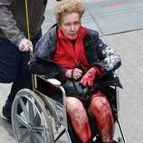 BOSTON - APRIL 15: (EDITOR'S NOTE: THIS IMAGE CONTAINS GRAPHIC CONTENT) A person who was injured in an explosion near the finish line of the 117th Boston Marathon is taken away from the scene in a wheelchair.