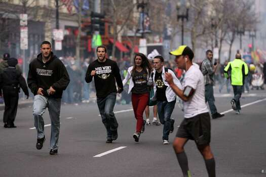 In this photo provided by The Daily Free Press and Kenshin Okubo, people react to an explosion at the 2013 Boston Marathon in Boston, Monday, April 15, 2013. Two explosions shattered the euphoria of the Boston Marathon finish line on Monday, sending authorities out on the course to carry off the injured while the stragglers were rerouted away from the smoking site of the blasts. (AP Photo/The Daily Free Press, Kenshin Okubo) MANDATORY CREDIT Photo: Getty Images