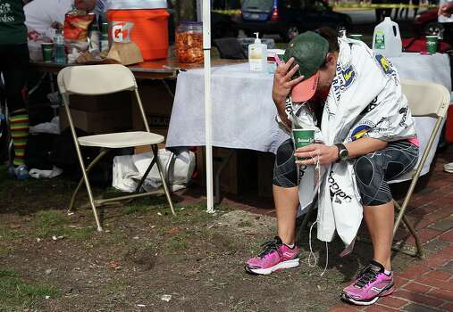 BOSTON, MA - APRIL 15:  A runner sits near Kenmore Square after two bombs exploded during the 117th Boston Marathon on April 15, 2013 in Boston, Massachusetts. Two people are confirmed dead and at least 23 injured after two explosions went off near the finish line to the marathon. Photo: Alex Trautwig, Getty Images / 2013 Getty Images