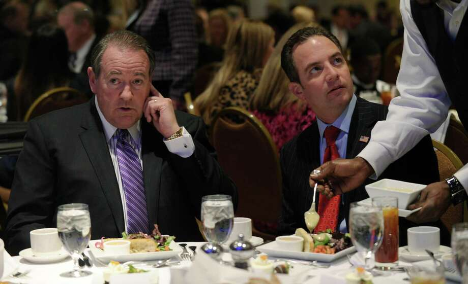 Former Arkansas Gov. Mike Huckabee (left) sits next to Republican National Committee Chairman Reince Priebus at the RNC's winter meeting in Washington on  Jan. 23. It was then that Huckabee said Democrats believe women need the federal government to protect them from their own libidos. Photo: Susan Walsh, Associated Press / AP