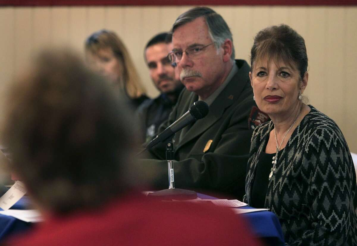 Rep. Jackie Speier moderates a public meeting in the Trocadero Clubhouse at Stern Grove to discuss the GGNRA's proposed rules and restrictions on off-leash dogs in San Francisco, Calif. on Thursday, Jan. 30, 2014. Seated at left is Frank Dean, superintendant of the GGNRA.