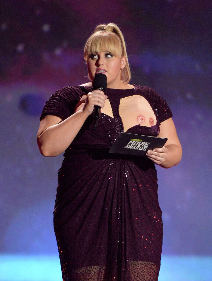 Rebel Wilson fakes a wardrobe malfunction onstage during the 2013 MTV Movie Awards.  Photo: Kevork Djansezian, Getty Images / 2013 Getty Images