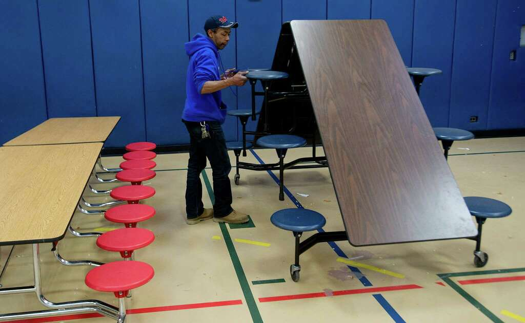 ron cherry folds a cafeteria table at springdale elementary school in stamford conn